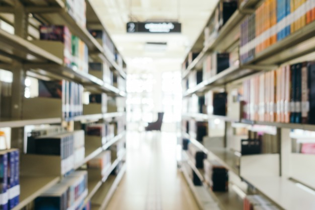 abstract-blur-and-defocused-bookshelf-in-library_1203-9639